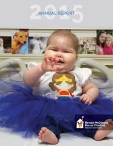 Cover of 2015 Annual Report with Audrey in a tutu