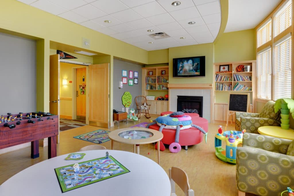 Playroom in the west wing with chairs, tables and toys