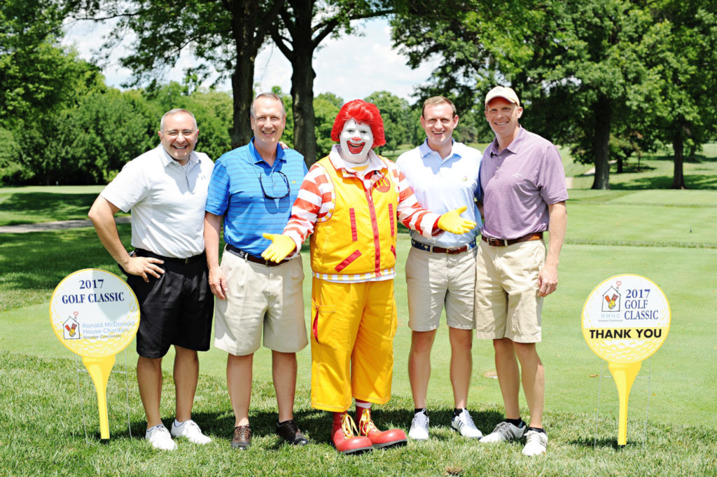 Group of golfers from Cincinnati Financial with Ronald McDonald
