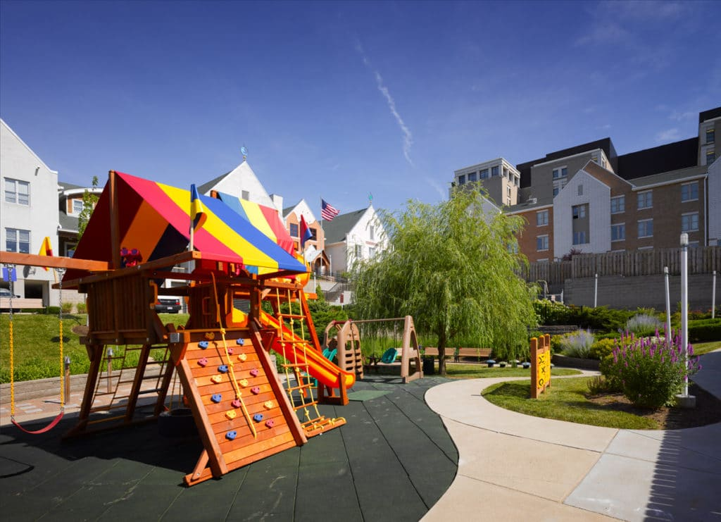 Outside view of playground and the House in the background