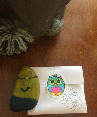 Minion painted rock with envelope