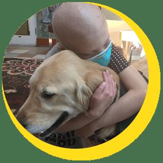 Young girl hugging a golden retriever dog